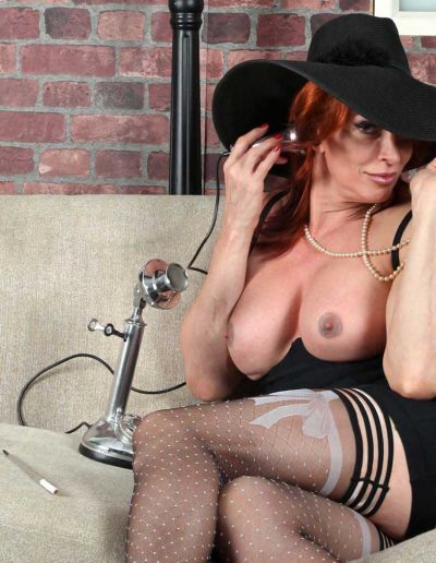 Lady D at Cafe with Hat on the Phone 1800 X 1200 160 Landing O