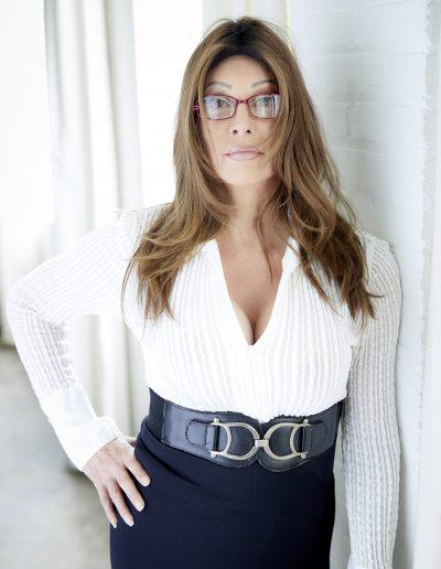 TSDee Assertive Controlling Women Glasses Against Wall P 084